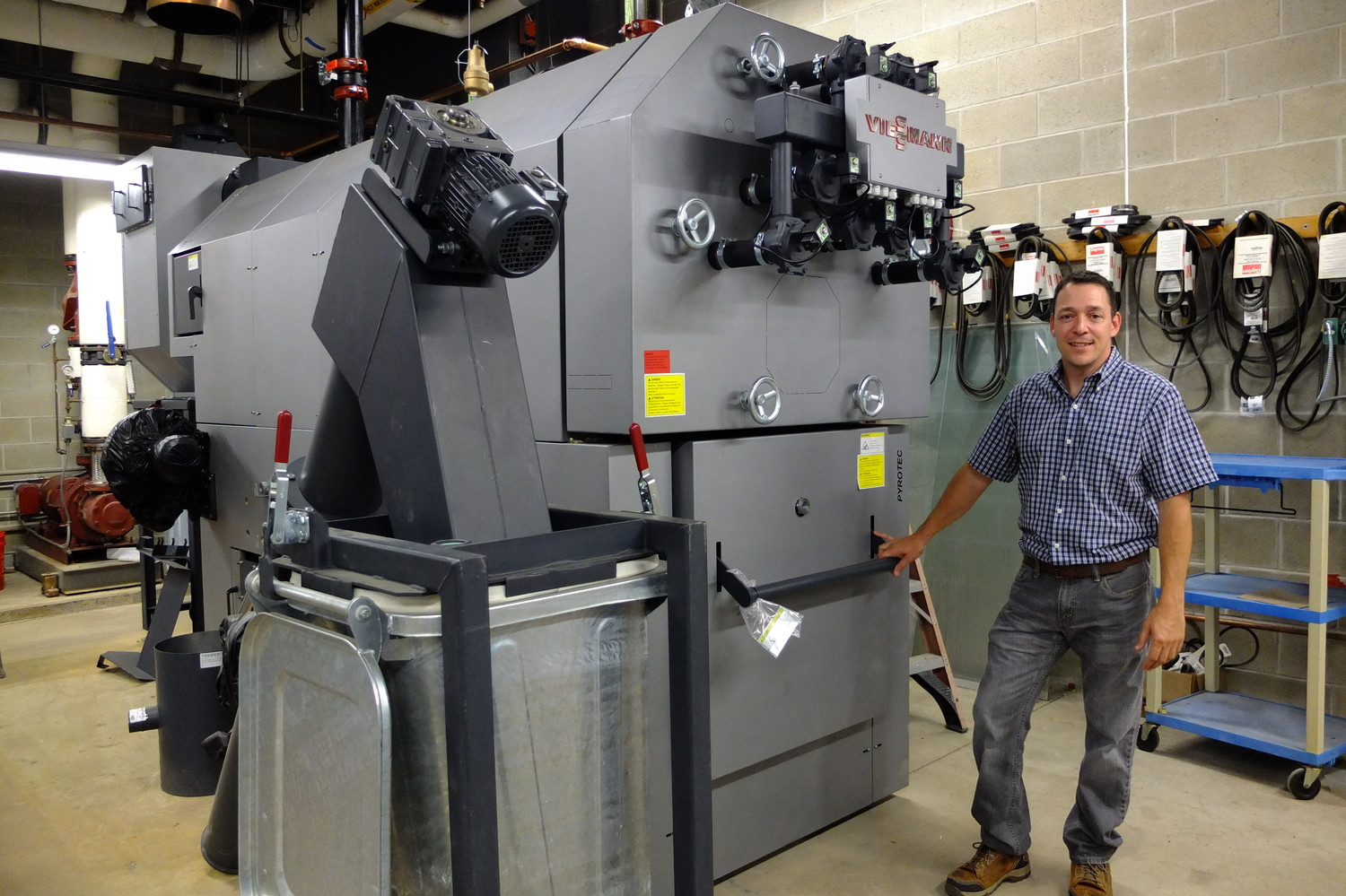 Dave Nappi stands near new high school boiler system.