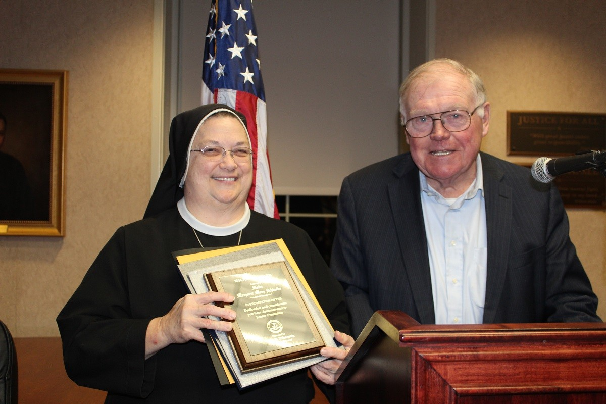 Sister Margaret Mary Schissler receives the Attorney General Dennis Roberts Justice Award for Senior Protection