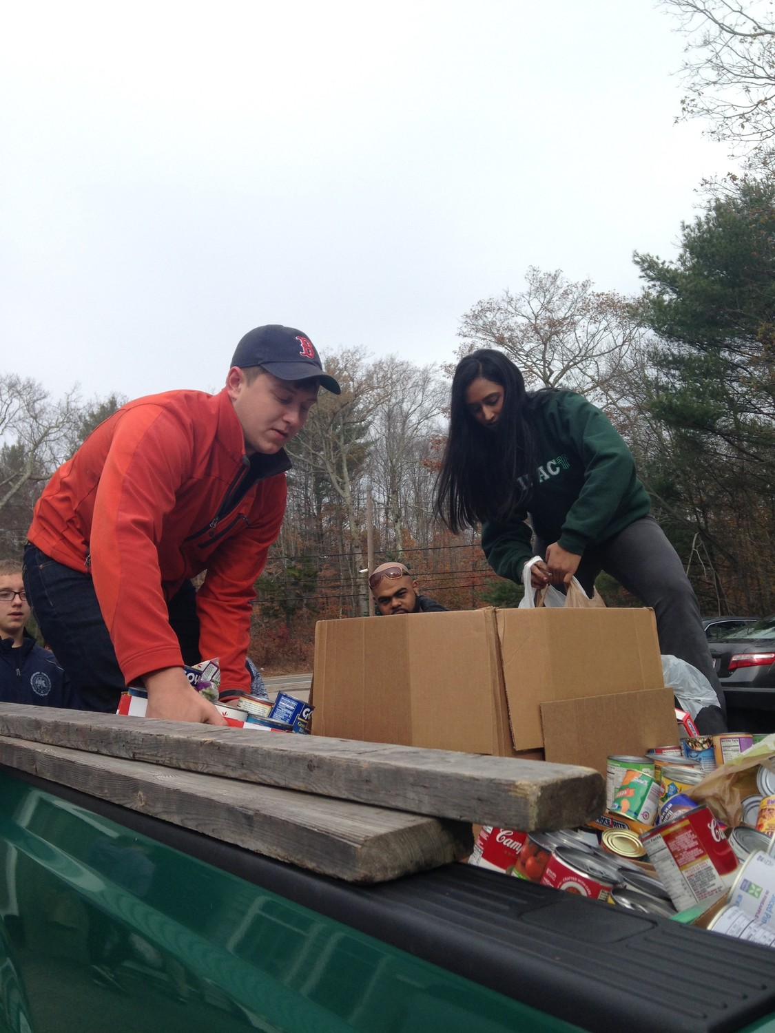 Owen Conti and Hannah Philip help to unload canned goods""