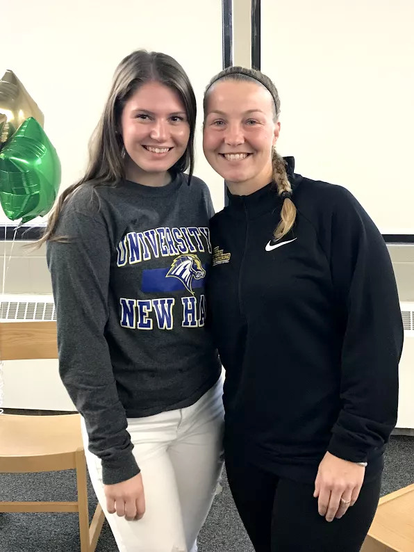 Mia Iodice with her pitching coach Janelle Carlson, Organizer of the Lady Sting Softball.  Missing from photo Don DiBiasio, SE Mass Xtreme Travel Coach