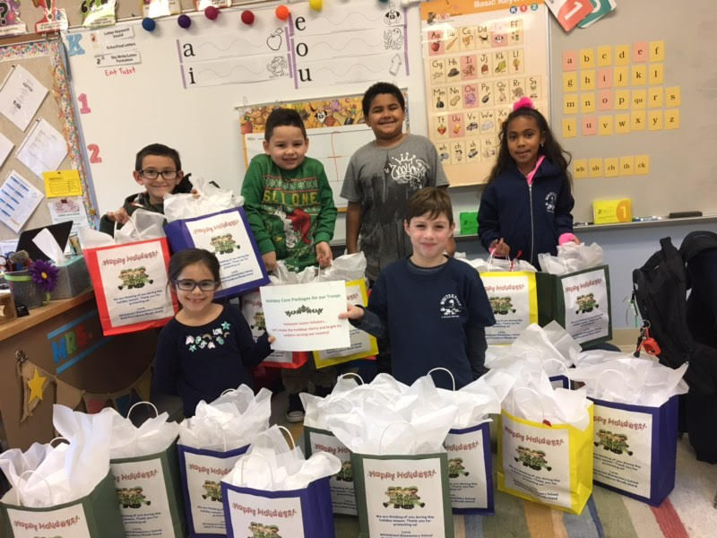 2nd graders helping with troop collections