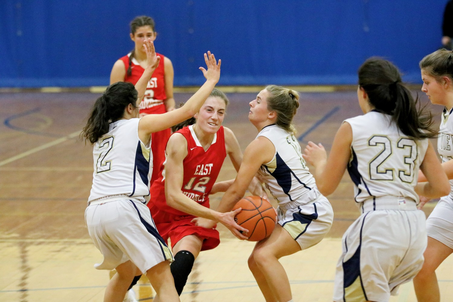 Lilian Conti of EP drives through BayView defenders in a intra-city basketball clash.  Photo by Paul Tumidajski.