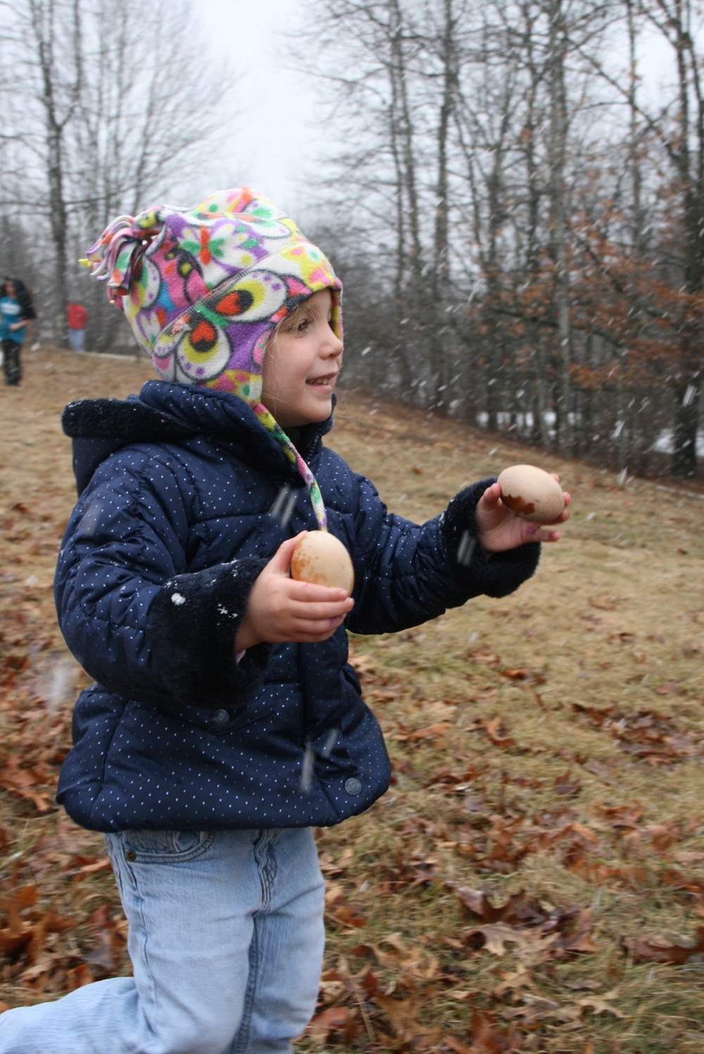 Elizabeth Benedict finds some well-hidden eggs during a previous event at Audubon Powder Mill Ledges Wildlife Refuge in Smithfield.