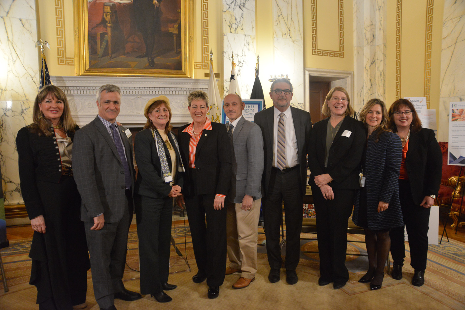 From left, Rep. Carol Hagan McEntee, Rep. Jason Knight, Rep. Deborah Ruggiero, Sen. Cynthia A. Coyne, Sen. Louis P. DiPalma, Coalition for Children and Families Board Chairman Benedict F. Lessing Jr., Coalition Executive Director Tanja Kubas-Meyer and Lisa Tomasso and Darlene Allen, Coalition Legislative Committee chairwomen.