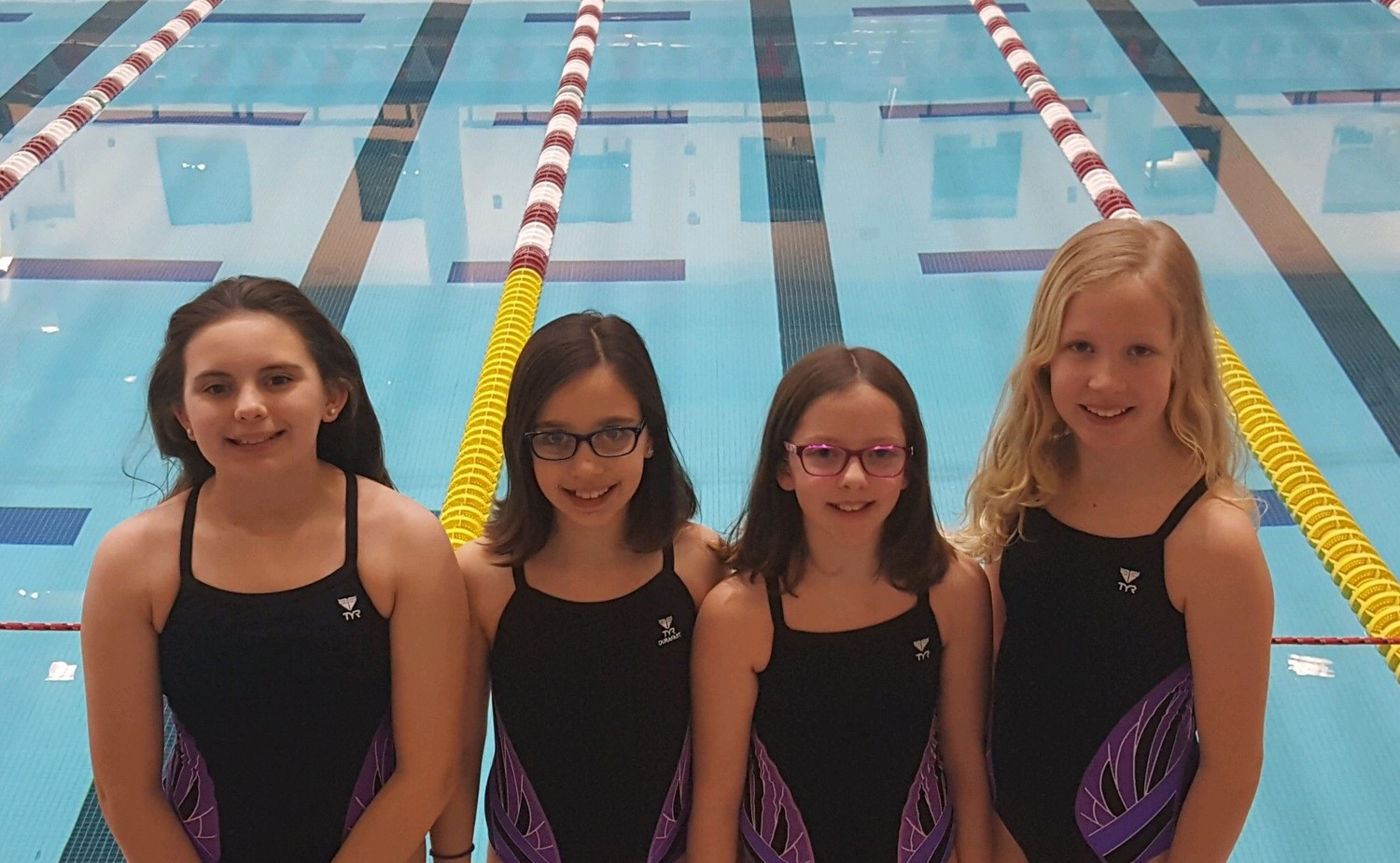 Vanessa Cook, Grace Baldassi, Julia Tortolani, and Delaney Carlsten all of  Seekonk represent the Newman YMCA at the 2018 N.E. YMCA Swimming Championships held at MIT on March 10, 2018.