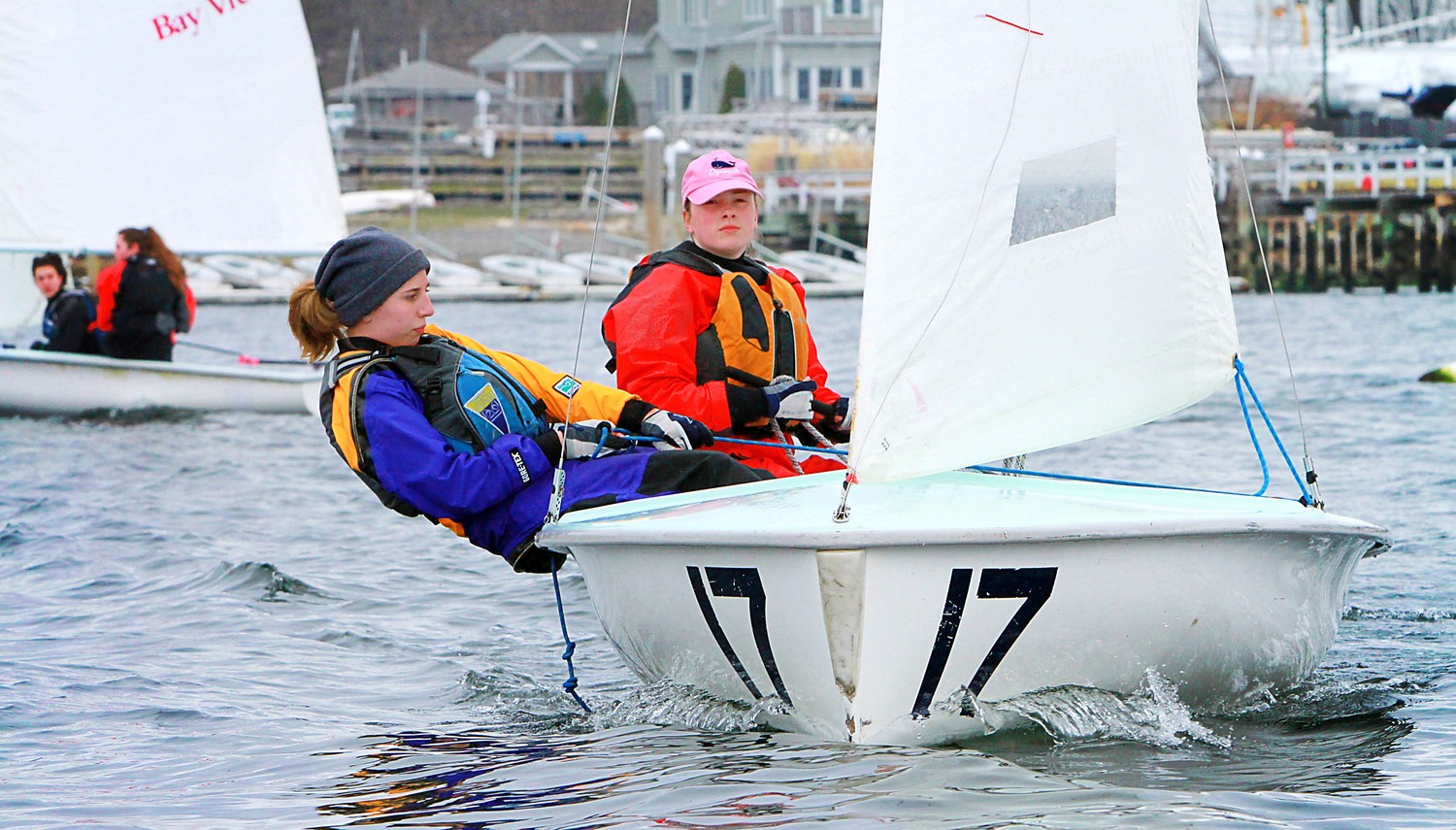 Kari Perez (front) hiking her boat, during a recent sailing practice as the team get ready for spring competition