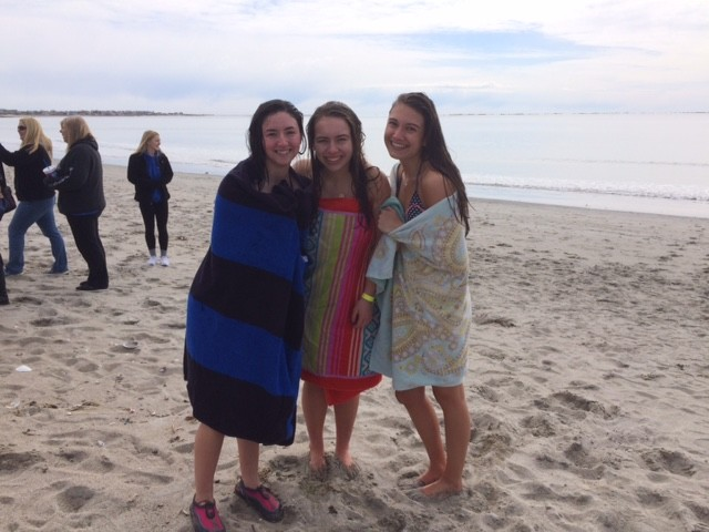 Members of the Bay View Plunge Team huddle together after plunging for Special Olympics RI