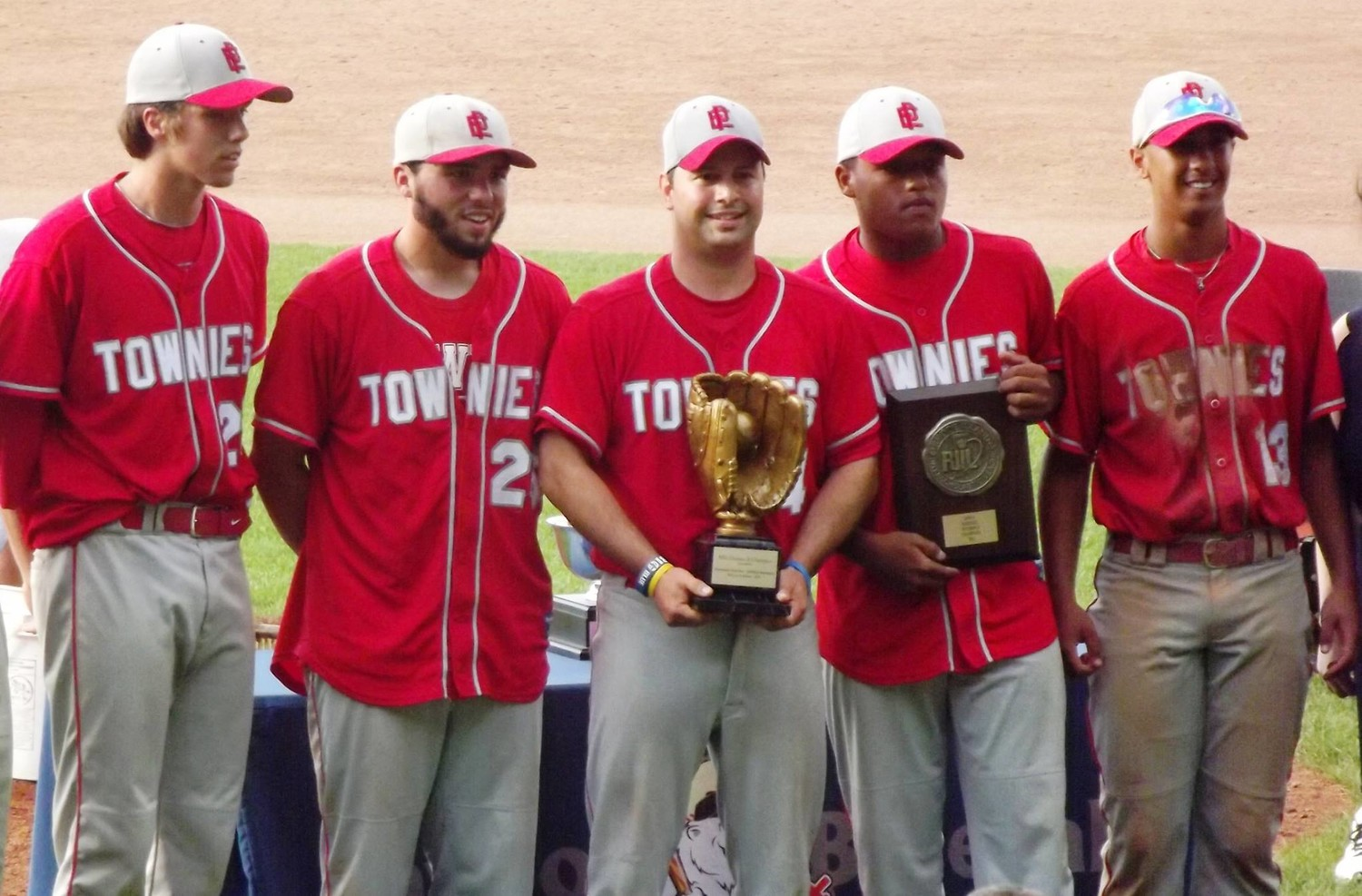 Head coach Bobby Rodericks (center) and EP captains, L to R, Keith Grant, Collin Costa, CJ Woods and Jasiah Hatch in 2014 State Title photo.