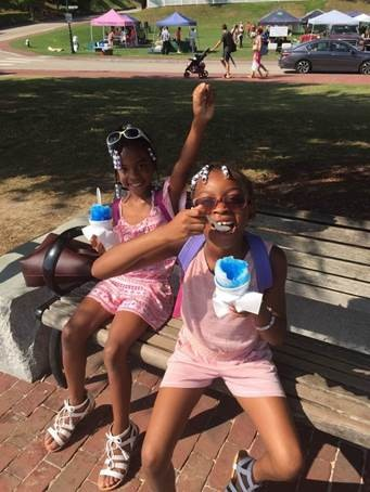 Nine-year-old Fresh Air child, Imani, of Brooklyn, and eight-year-old host sister, Jadd, of Hampton Roads, VA, cooled off on a hot summer day with snow cones in the park. The best friends have spent the past two summers together going to the beach, reading at the library, and hosting movie nights!