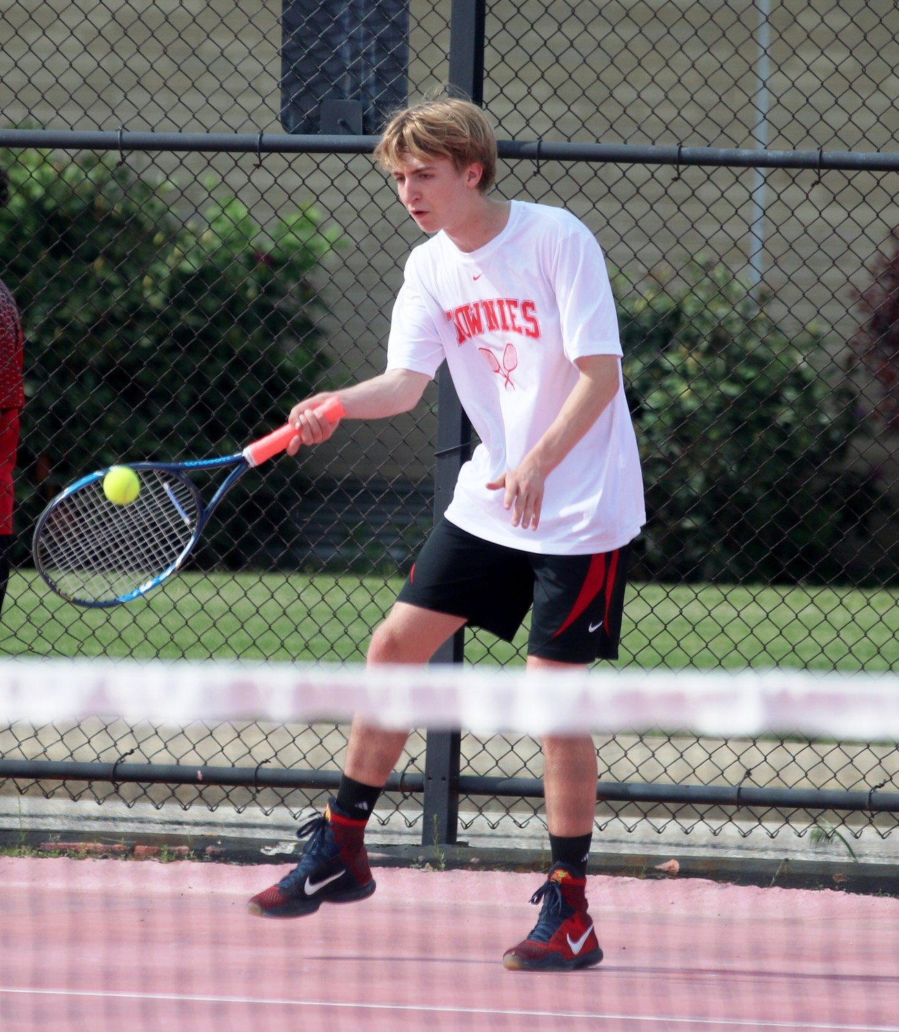 Dan Forsythe returning volley for EP in tennis action.