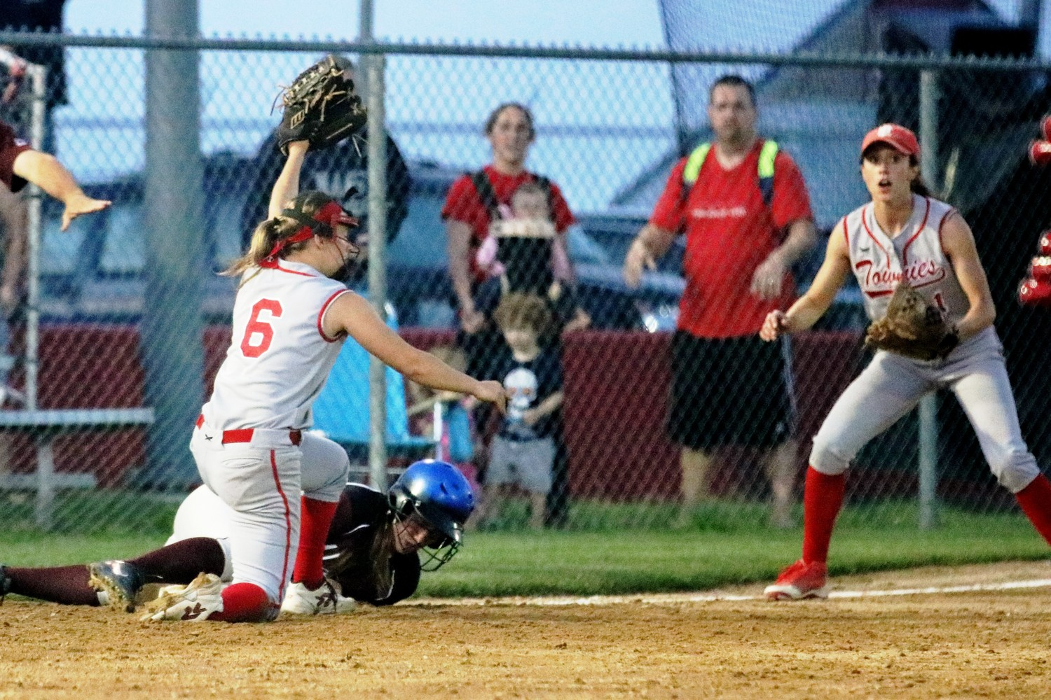EP's Taylor Babcock trys to tag a Woonsocket runner out at third.