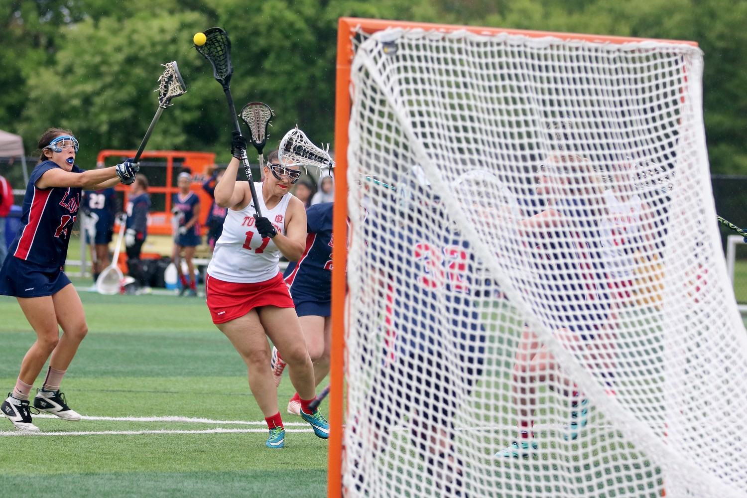 Jessica Costa takes a shot vs Lincoln in lacrosse match.