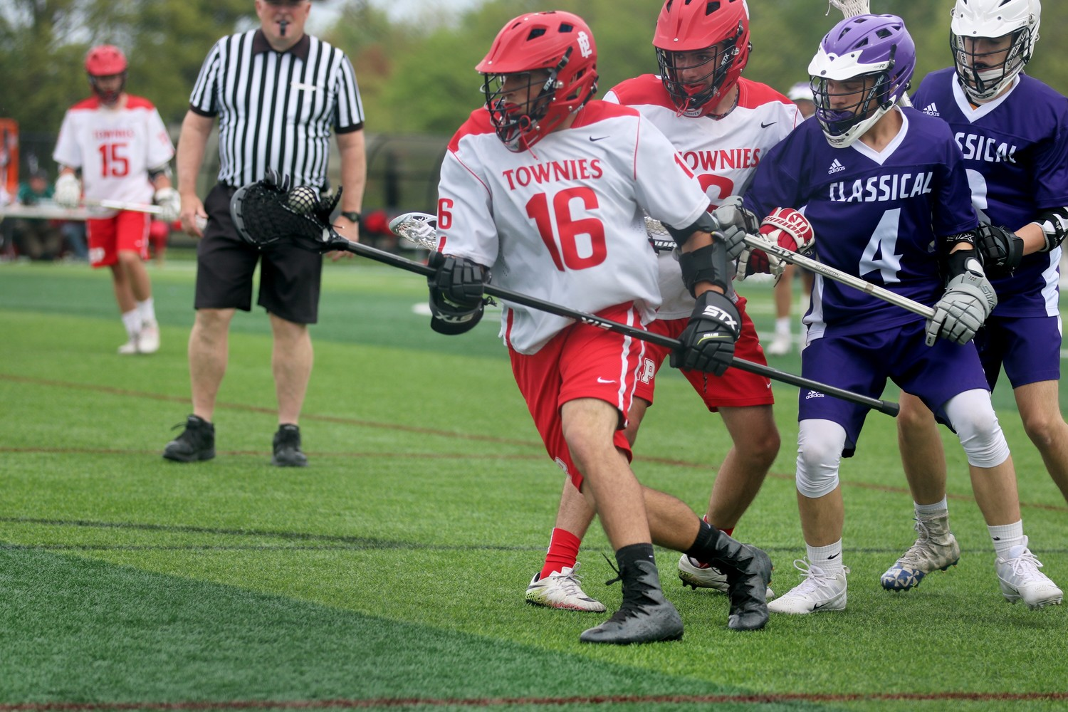 Richard Maciel leading the Townies down field in lacrosse action.
