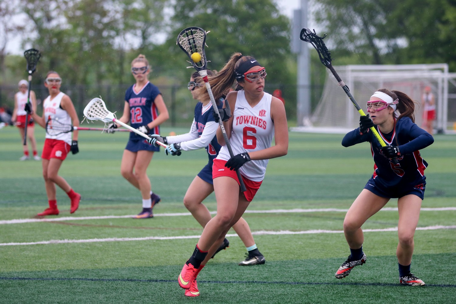 Sophia Monteiro in Townie lacrosse action