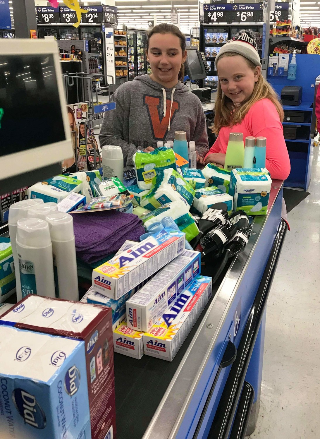 Payton Rotkoski and Sophia Santos shopping for donations after bake sale.