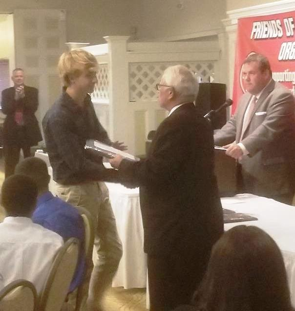 Former EPHS AD Ken Reall presenting award to Dan Forsythe, Male Student-Athlete of the Year.