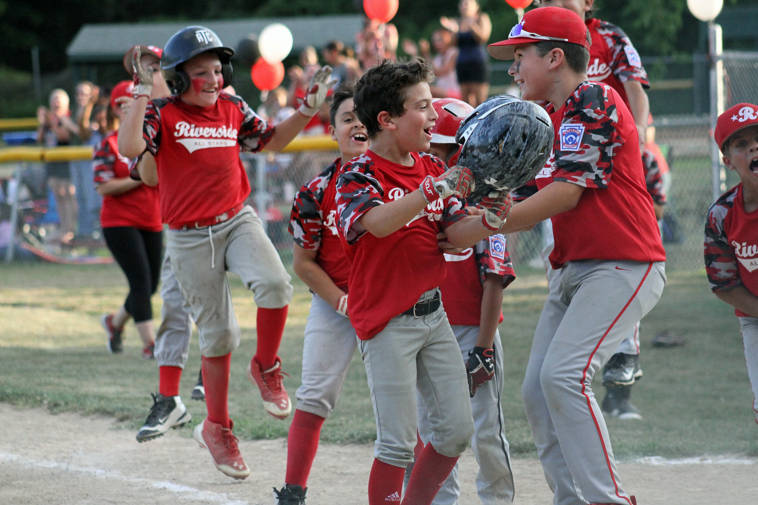 Riverside 9-10 all-stars start to celebrate title win over Rumford.  Photo by Tyler Saunders Maxwell