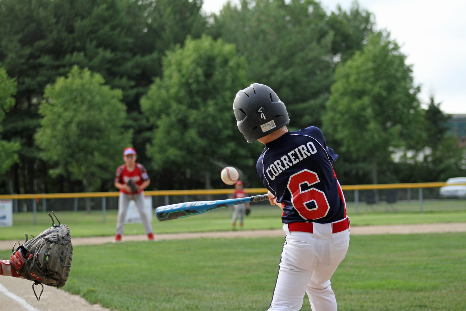 Max Correiro of Rumford at bat. Photos by Tyler Saunders Maxwell.