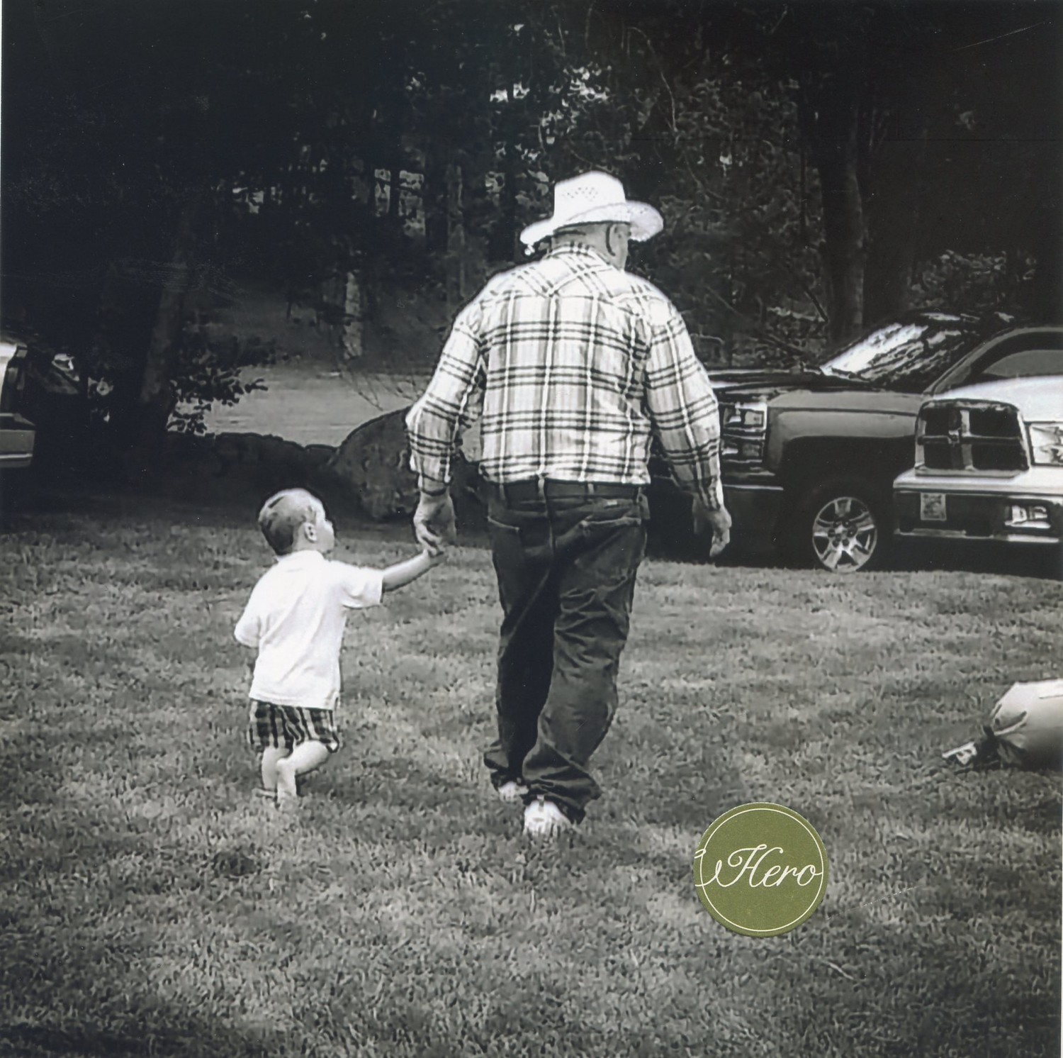 George shows his grandson how to walk like a cowboy.