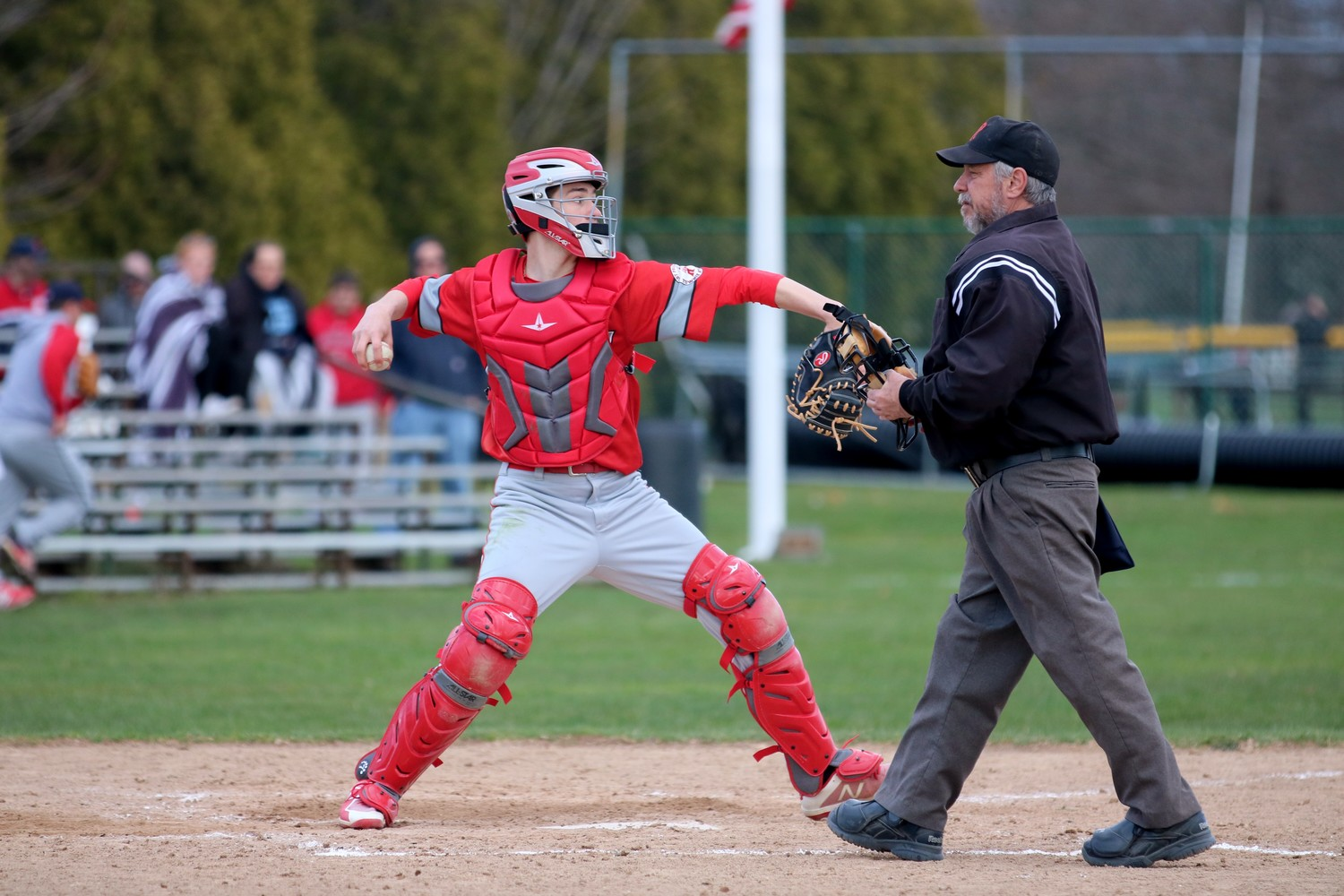 EP catcher Cole Poissant making a throw to second base.  Photo by Paul Tumidajski.