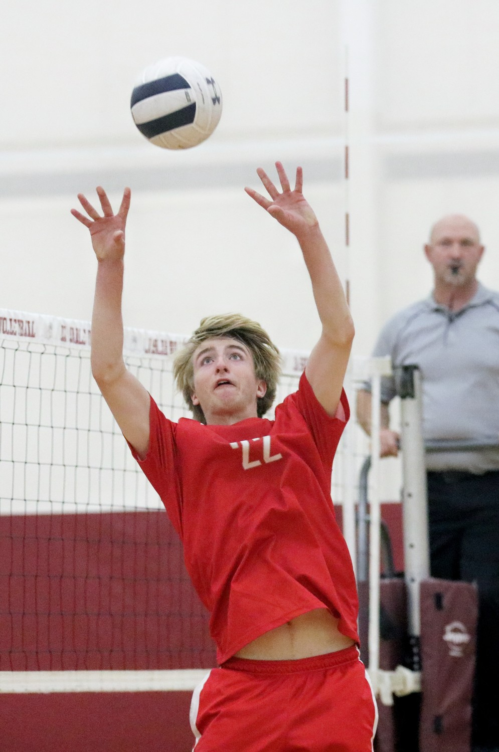 Townie All-Stater Dan Forsythe setting vs LaSalle in an EP volleyball win.  Photo by Paul Tumidajski.