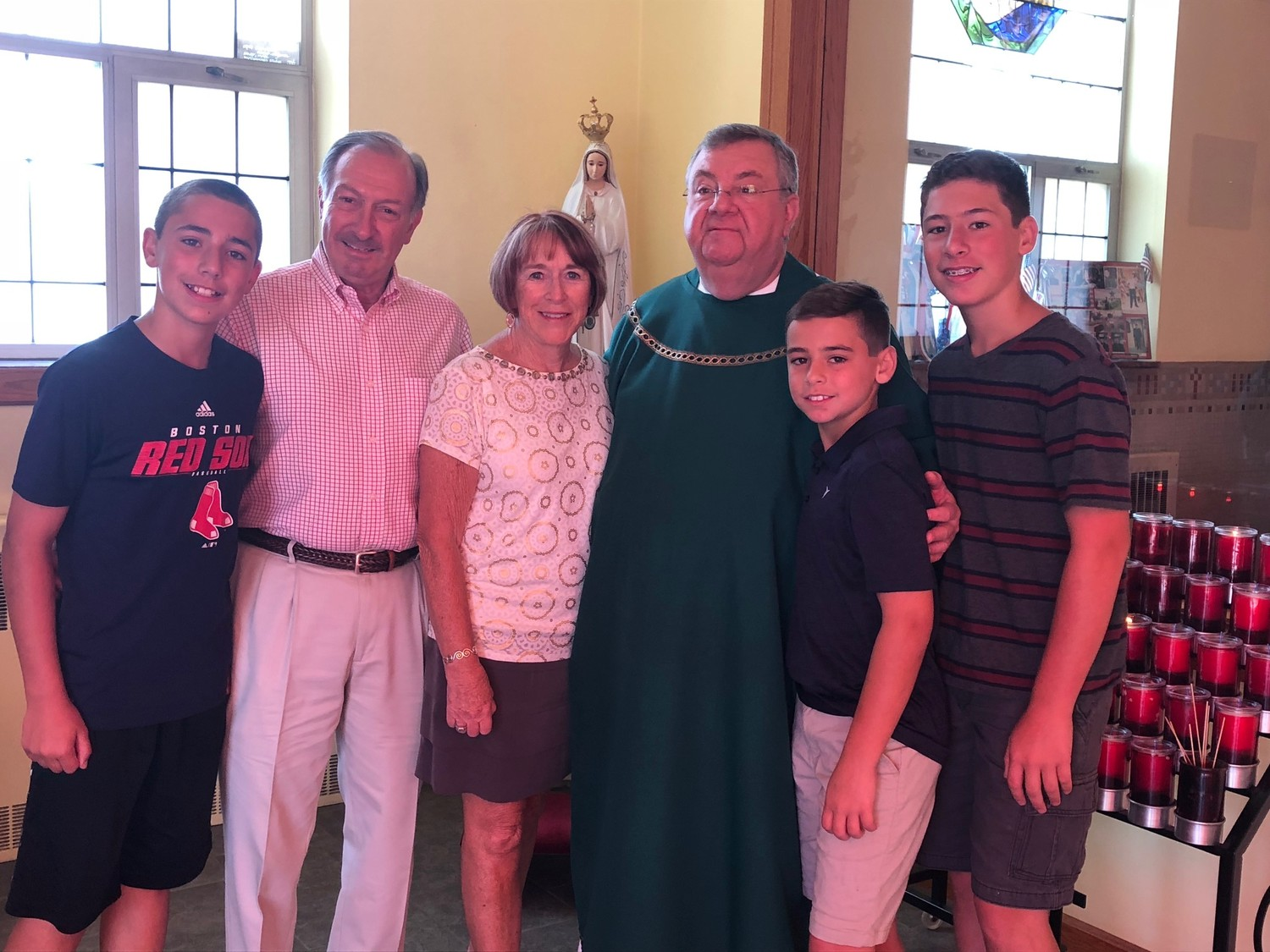 L-R: Josh Cote, Fred Guarino, Pamela Guarino, Fr. Green, Ben Cote, Alex Cote