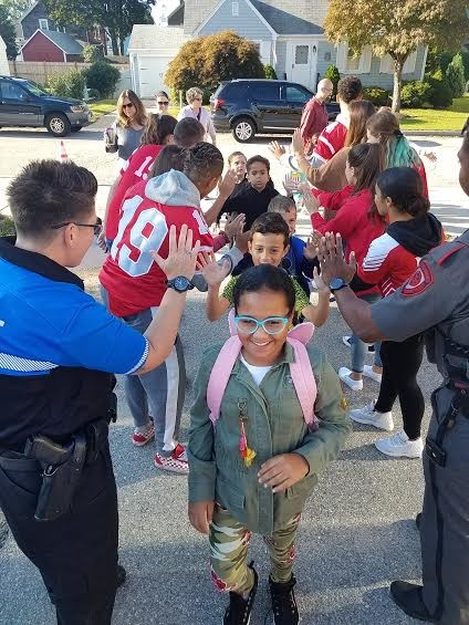 EPHS student athletes and School Resource Officers greet arriving elementary students at their schools every Friday morning.
