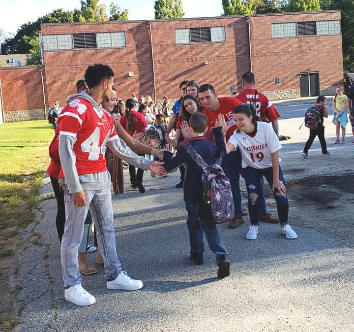 High-five Friday at Kent Heights school has high schoolers greeting elementary students as they arrive for class.