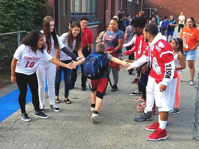 Whiteknact school students greeted by EPHS Student-Athletes  in September.