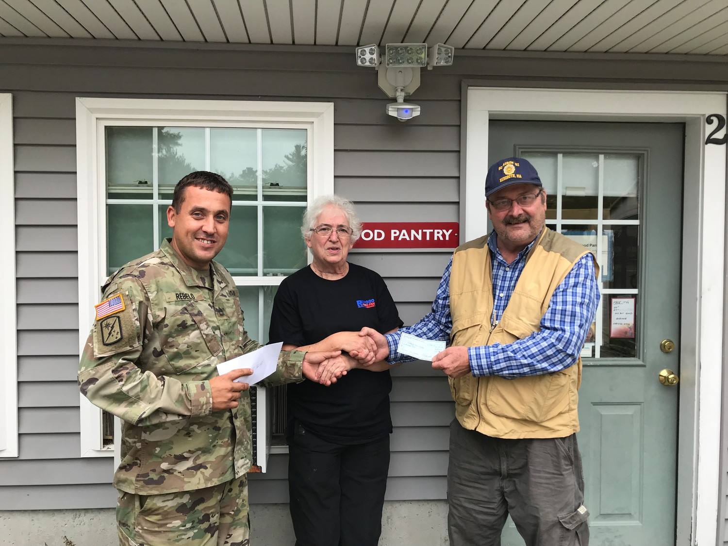 On the left, Luis Rebelo, Commander of the American Legion Post 302 along with the Commander of the Sons on the right, Mark Hass handing checks to the Rehoboth Food Pantry.