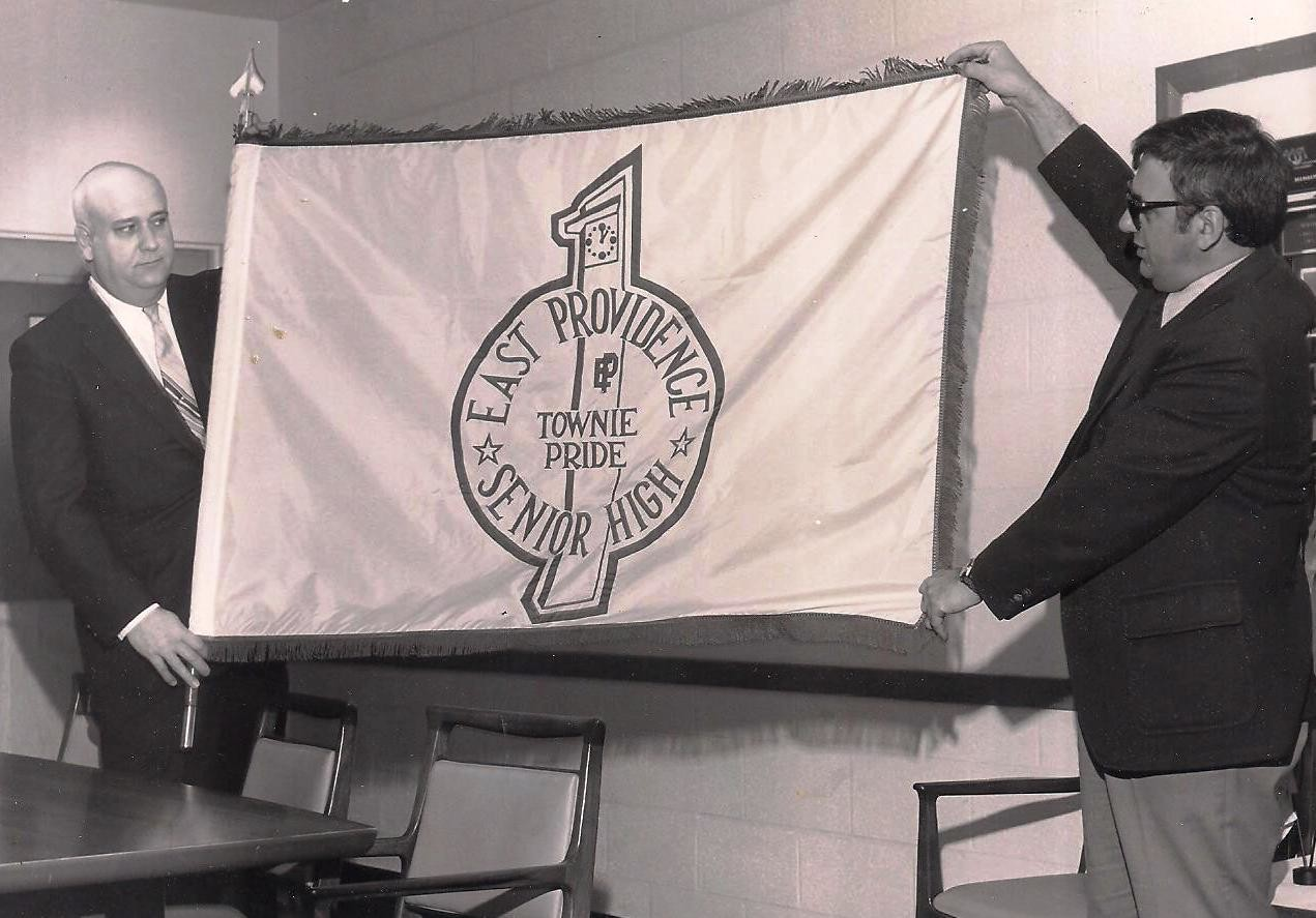 The late Myron J. Francis (left) and Peter Barilla unveiling the new Townie Pride logo in 1980.
