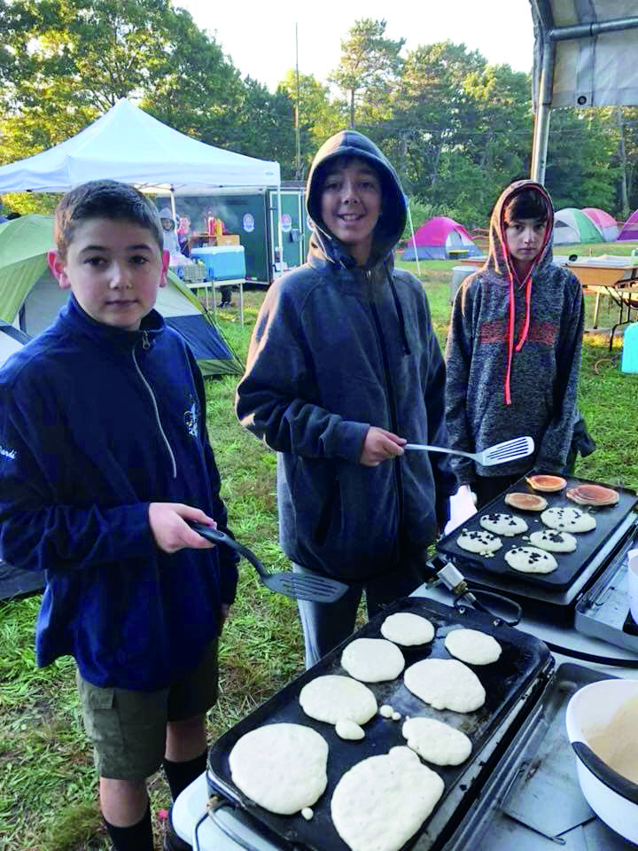 The boys are in charge of cooking all meals when we're camping. Here they're making chocolate chip pancakes for breakfast at Mass Jam.
