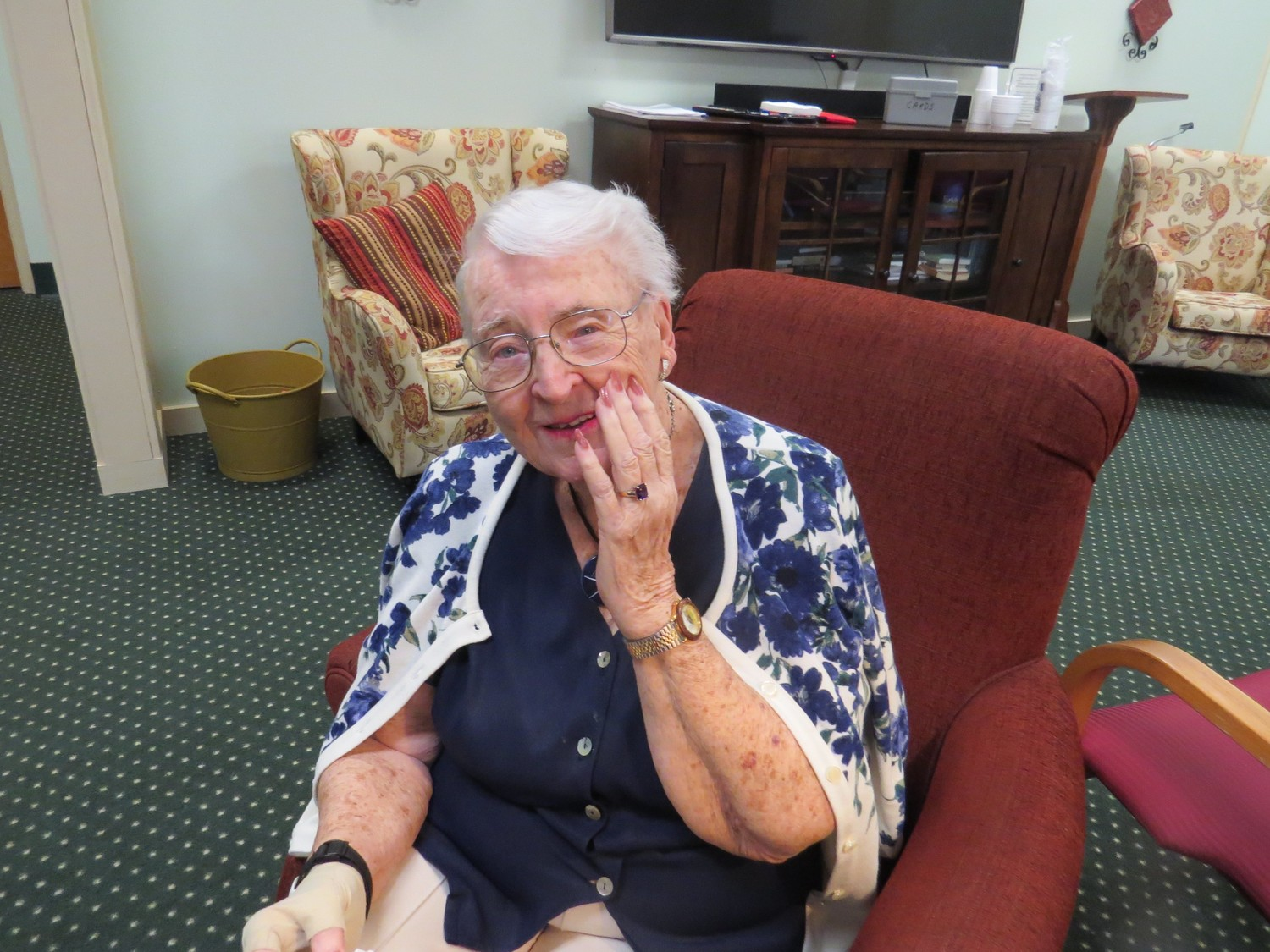 Reunited With Her Engagement Ring:  Winslow Gardens resident Emmalou Kirchmeier poses with her newly recreated engagement ring, a multi-carat emerald cut amethyst created by East Providence-based MRT Jewelers. The ring was her wish, granted by Aldersbridge Communities' newly launched ElderVentures program for its residents.