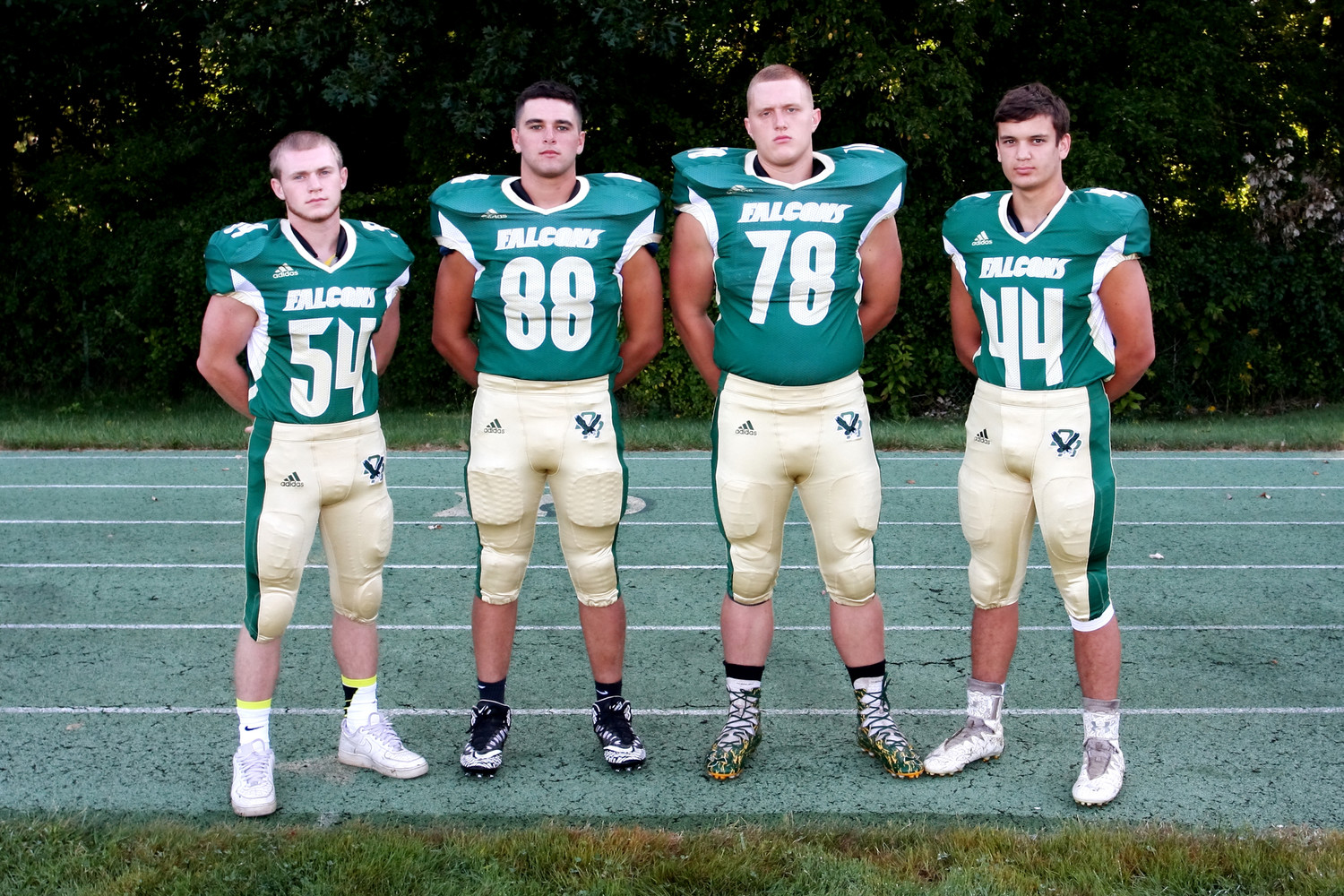 Team captains Dylan Iodice, Matt Moura, Mason Cardorette, and Chase Carroll
