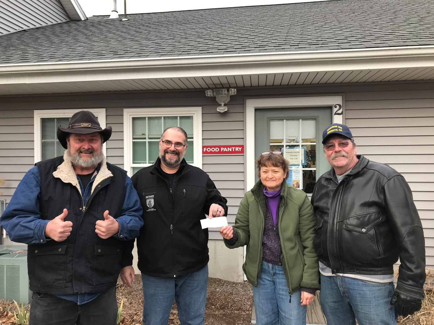 On the left, Mark Hass, the Commander of Sons of American Legion Post 302 along with the Vice Commander of the Sons on the far right, handing checks to Bill Dalape & Paula Fernandes of the Rehoboth Food Pantry December 20th in time for Christmas and the Holidays.