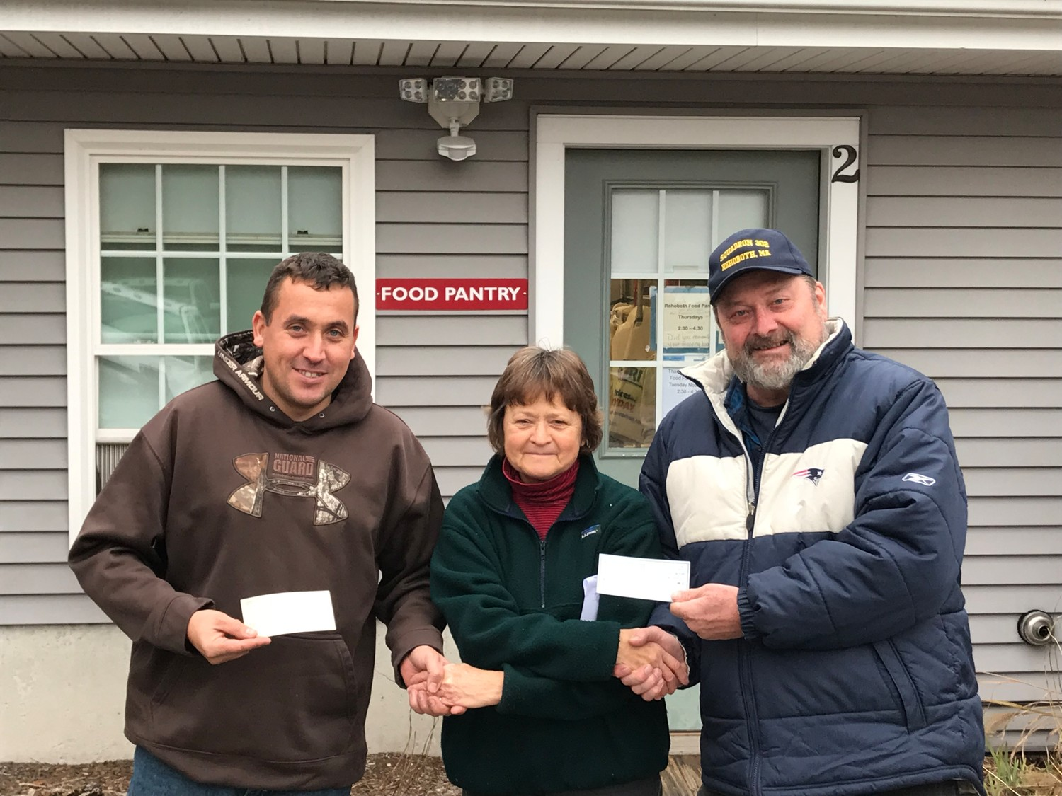 On the left, Luis Rebelo, Commander of the American Legion Post 302 along with the Commander of the Sons on the far right, Mark Hass handing checks to Paula Fernandes the Rehoboth Food Pantry on November 15th in time for Thanksgiving.