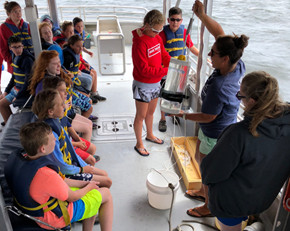 Campers in a 2018 Shipboard Camp sample water quality on a Save The Bay education vessel.