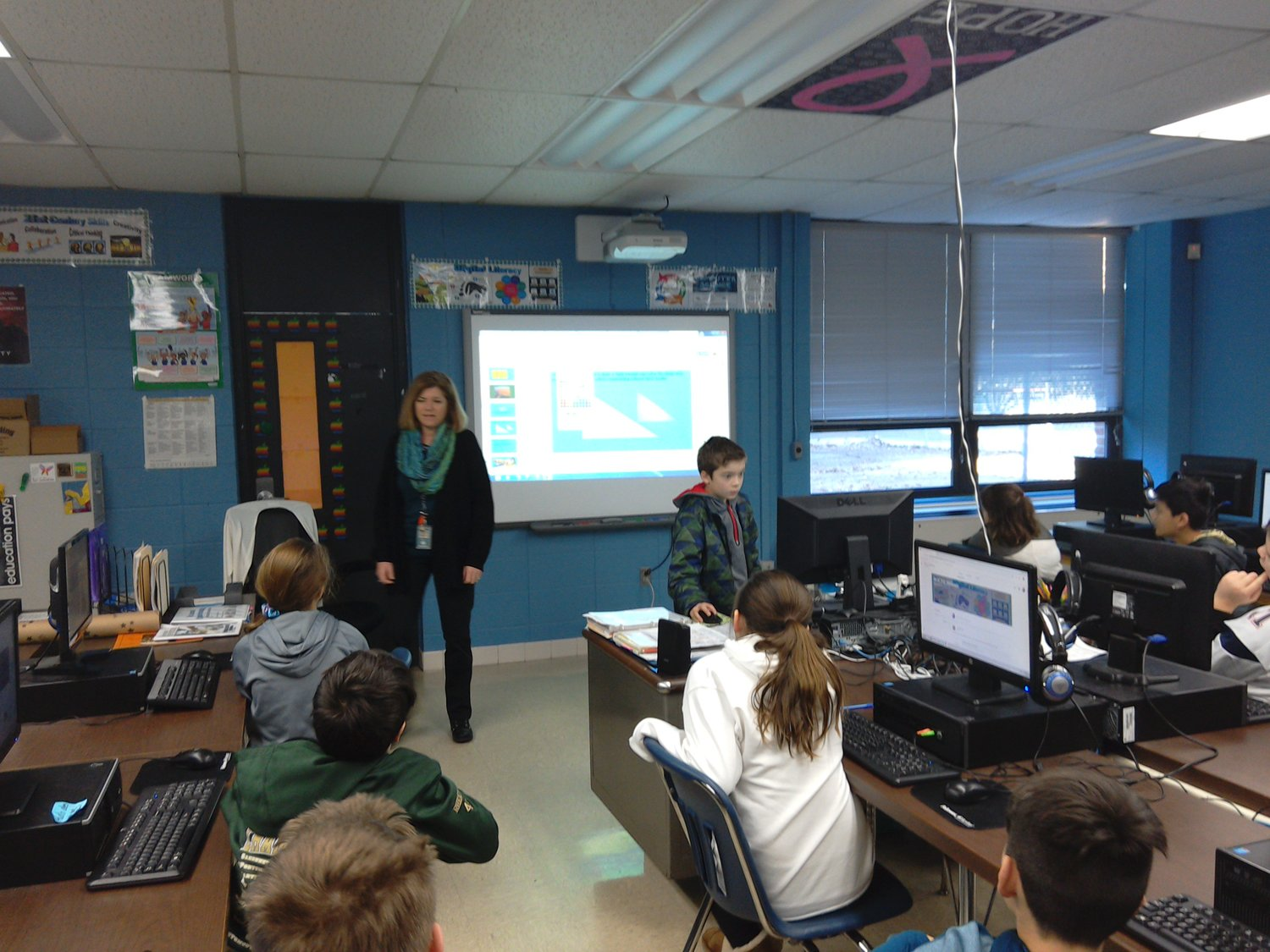 Learning In Action: A 5th grade student demonstrates how to insert a shape in a Google Slides presentation in Ms Darmody's Computer Science class.