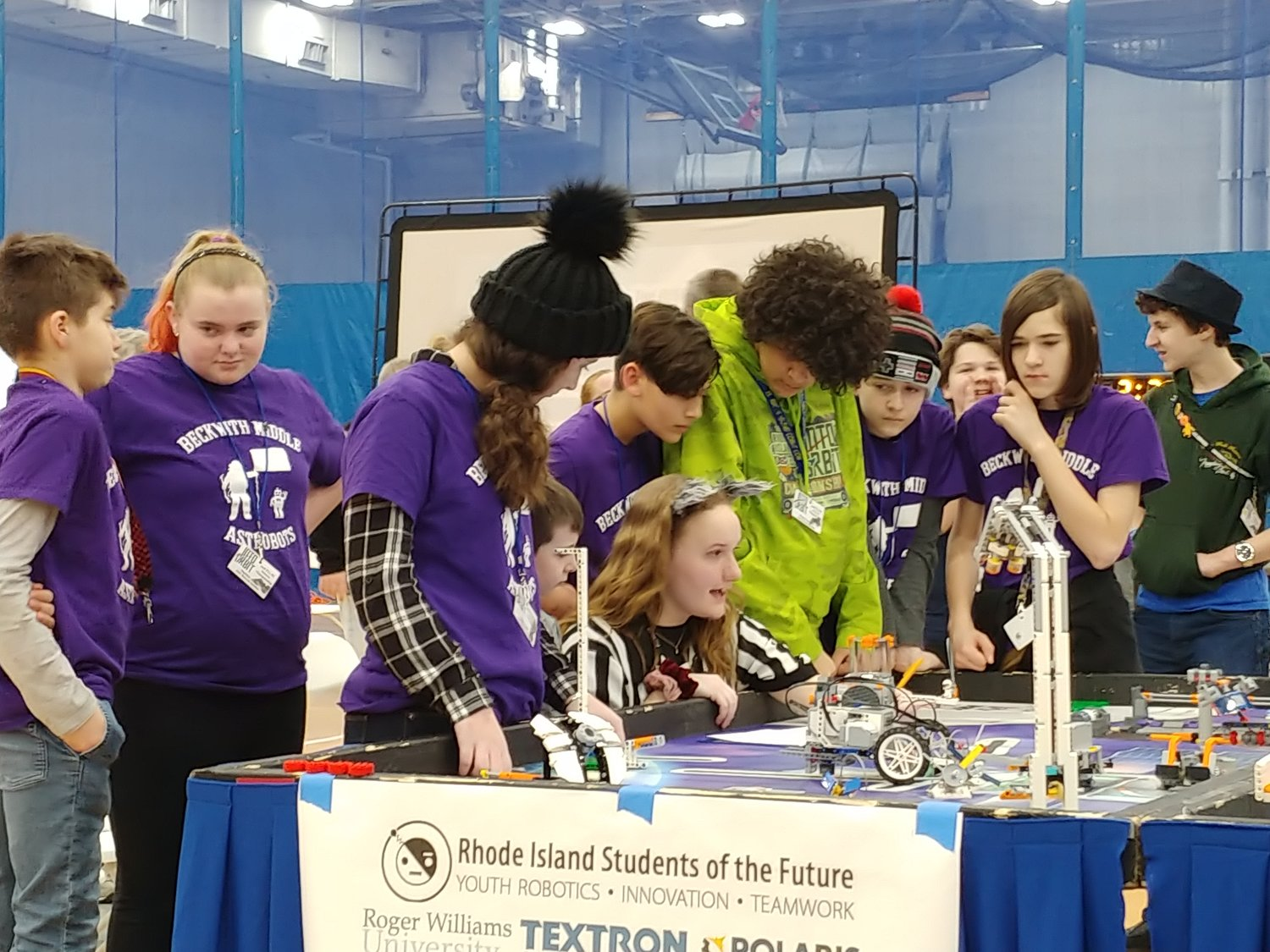 The Astrobots and referee at the FLL Championships at Roger Williams University