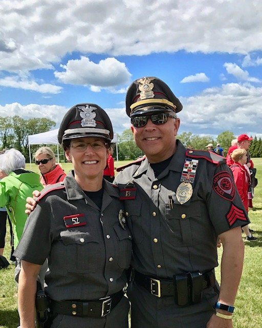 : (L to R) East Providence Police Cpl. Tammy David and Det. Sgt. Diogo Mello, are long-time volunteers with the Special Olympics of Rhode Island. Mello (R)  was selected to join the Final Leg team with 96 law enforcement officers throughout the world to carry the Flame of Hope leading up to the 2019 Special Olympics World Summer Games.