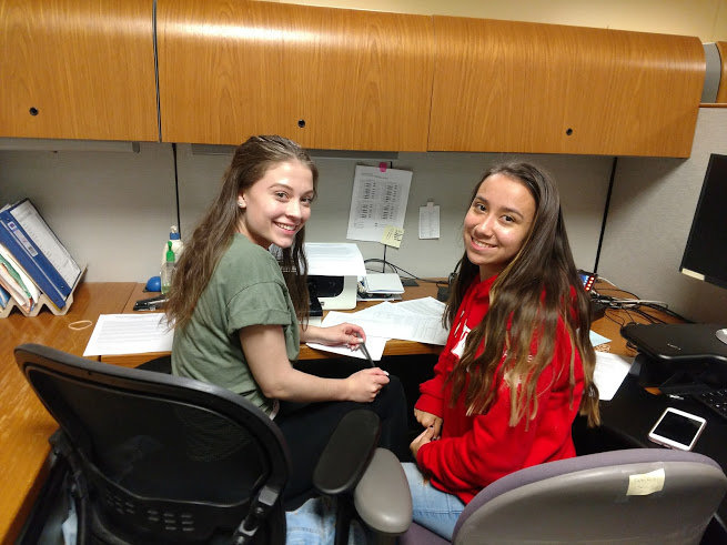 East Providence High School seniors Hailey Hannon and Lily Palumbo were among the volunteers contacting residents to support scholarships for East Providence students.