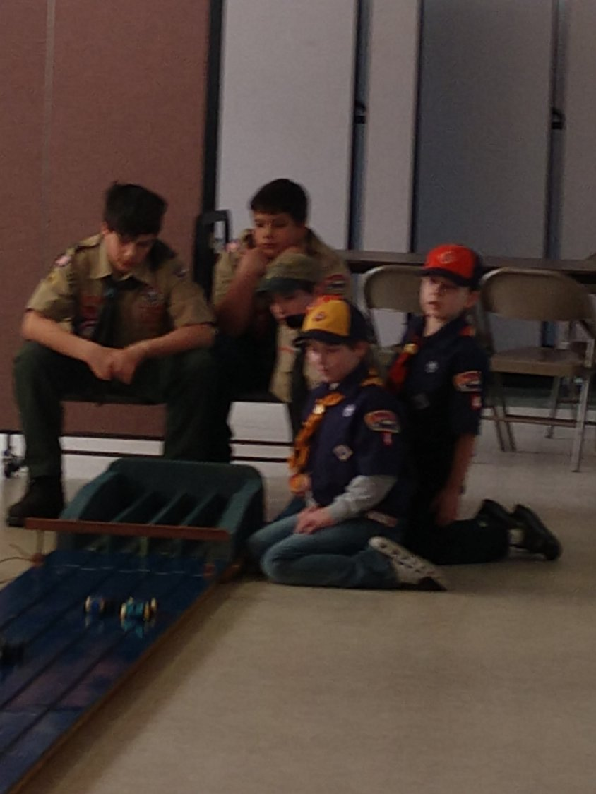 Scouts await their cars at finish line!