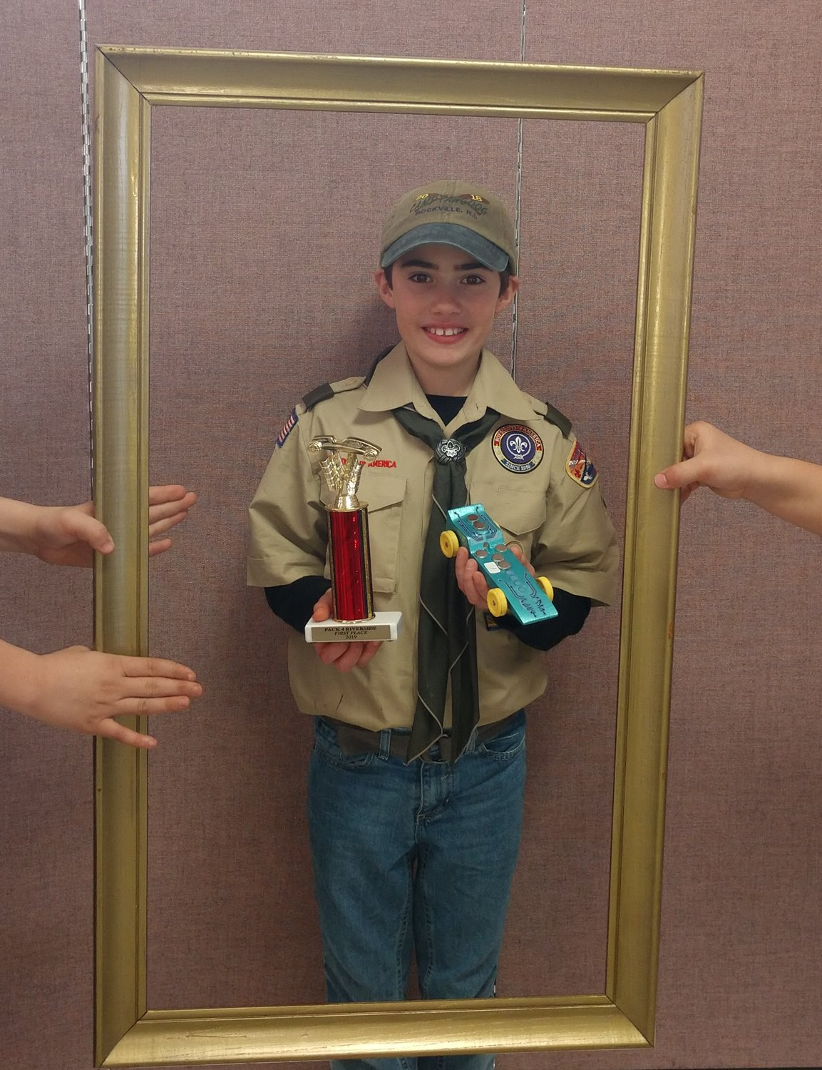 Andre DeVoto, fifth grade and last Pinewood Derby, takes first place for the win!