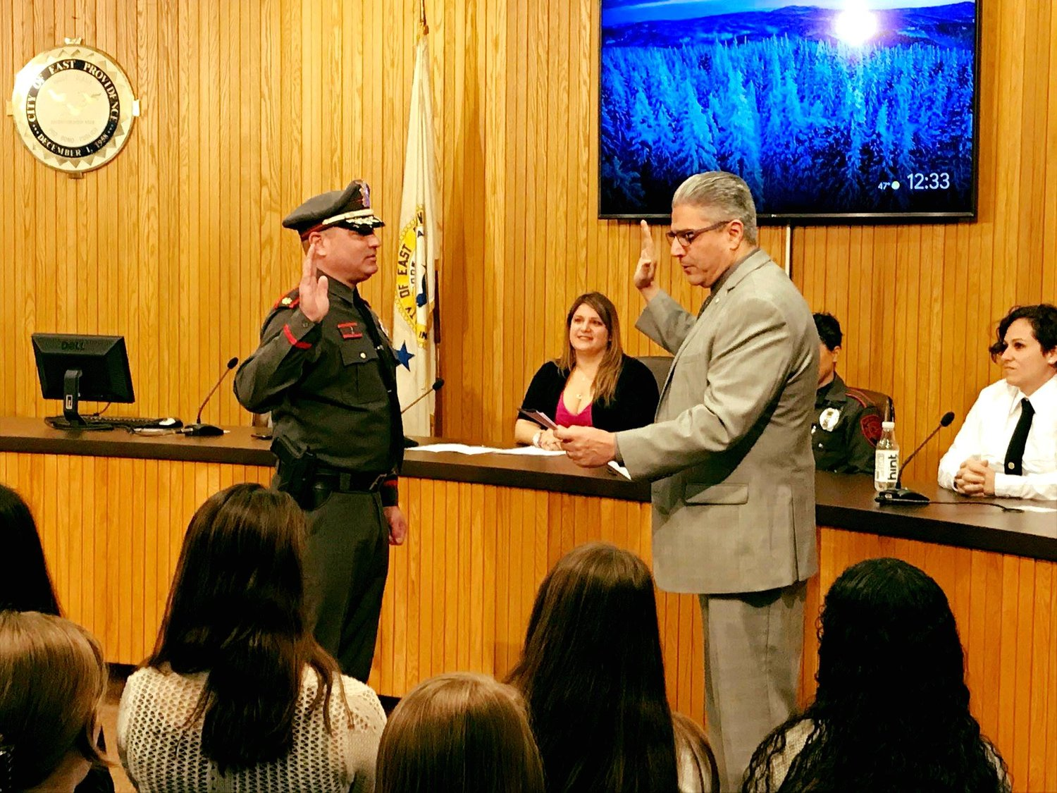 Police Chied Nebus being sworn in by Mayor Bob DaSilva
