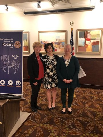 Karla Caldarone (Center) was inducted into the East Providence/Seekonk Rotary Club by Renate Alexander (Right) and her sponsor (Left) Lori DiPersio at Chelo's Restaurant.