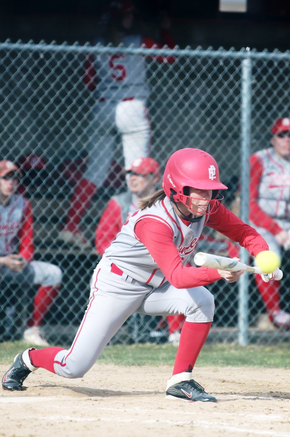 Paige Messier bunting for the Townies in recent softball action.