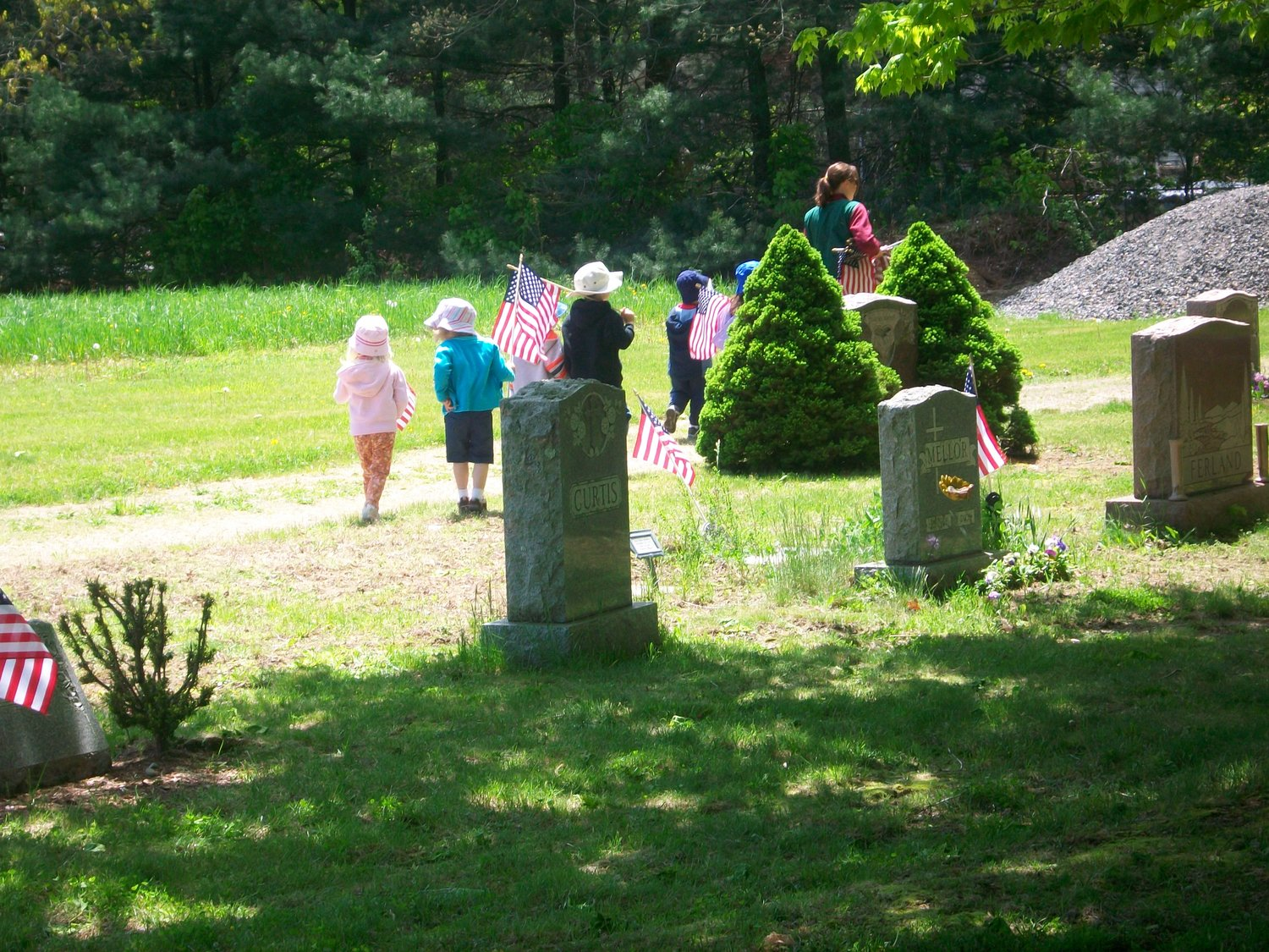 Children of Twin Oaks Farm Learning Center renew flags on Veterans Graves