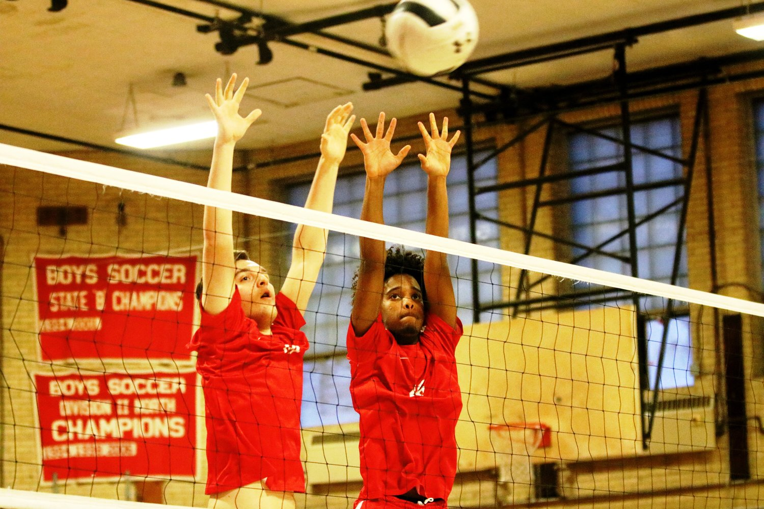 EPHS Ben Stone and Tiago Fernandez block a ball in volleyball match vs Tolman High. Photo by Paul Tumidajski