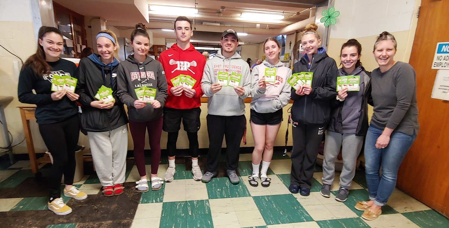 Townies Girls and Boys Lacrosse teams donated Shaw's gift cards to the Good Neighbors Soup Kitchen at St. Brendan's Church in Riverside.