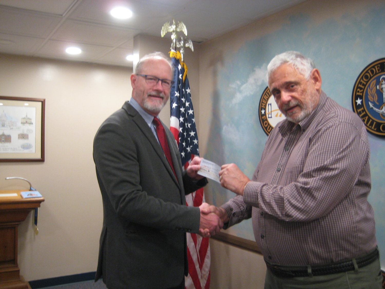 Scott A. Reese (L) Department Commander, RI Sons of Union Veterans of the Civil War receives a grant from Russ DeSimone, Grants Committee Chairman, Heritage Harbor Foundation. Mr. Reese is pledging the funds to the Friends of Vicksburg.